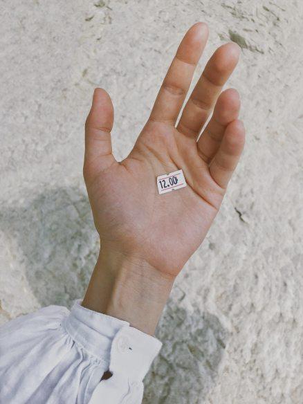 white-price-tag-on-human-palm-1201721